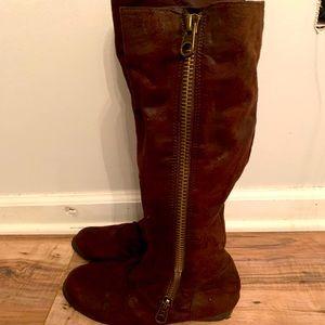 Brown tall zipper up boots